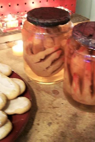 Shrunken Fingers in a Jar Halloween Prop made with apples | stowandtellu.com