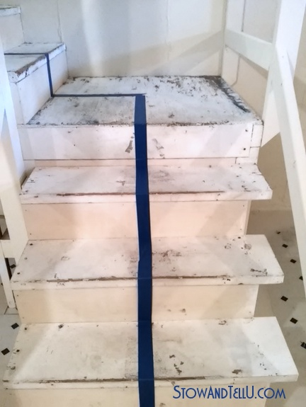 blue painters tape on wooden basement stairs