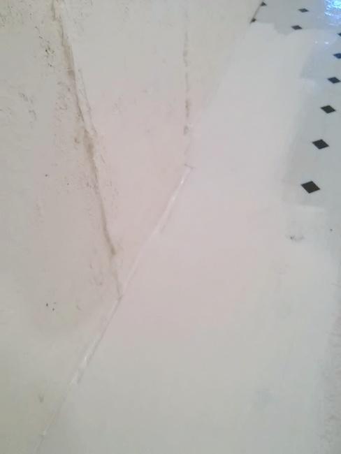 Priming basement floor with concrete walls