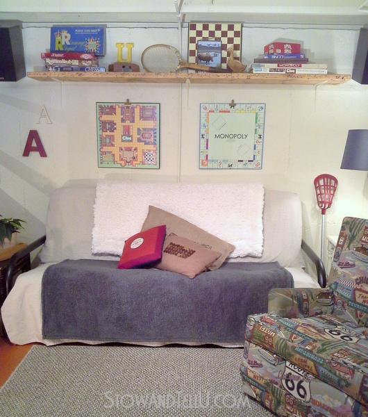game-room-decor-over-the-couch-shelf-https://stowandtellu.com