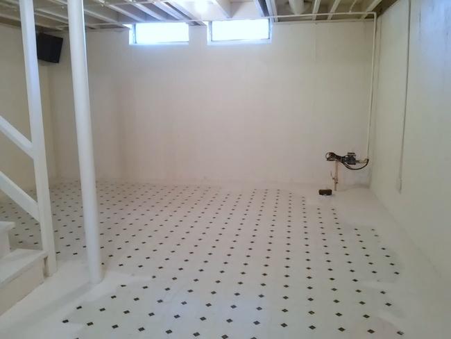 vinyl-basement-floor-being primed