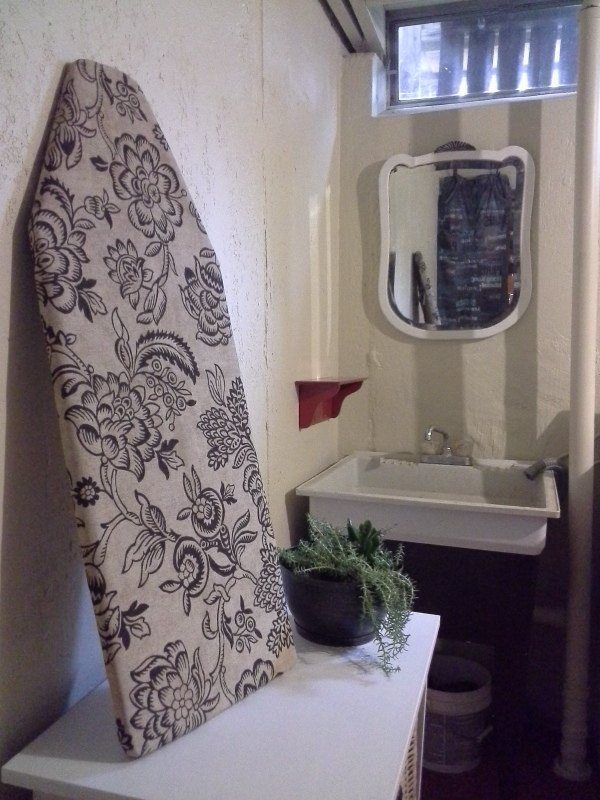 "diy 1 hour hand sewn ironing board cover is part of basement laundry room updated done almost exclusively with paint, several diy repairs and a ""use what you have"" approach from Stow and Tell U"