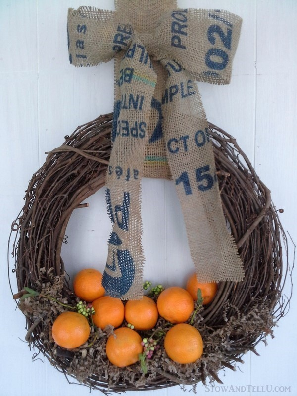 Celebrate winter with a citrus wreath using cuties and a coffee sack bow with blue ink for contrast from StowandTellU.com