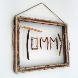 Twig name art for kids room. Fun nature crafts idea that can be fancy or a primitive nature project made by a child - StowAndTellU.com