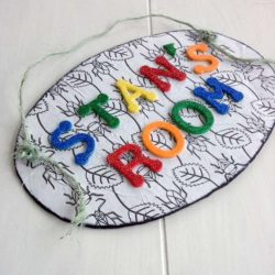 Kids name plate idea using an uncolored coloring page for the background, foam letters, decoupage, card board - StowandTellU.com