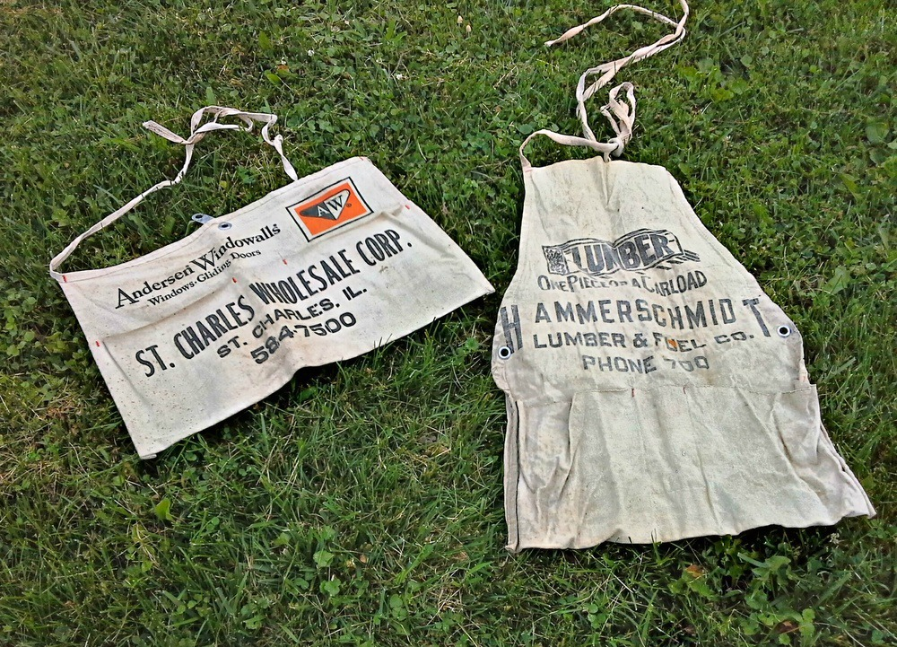 Vintage work aprons turned hanging storage - StowAndTellU.com