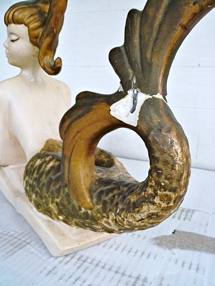 broken plaster mermaid sculpture