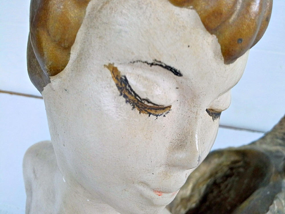vintage mermaid statue face