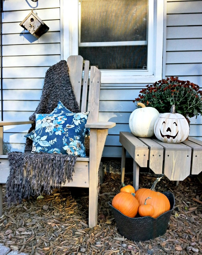 Fall porch and white painted Halloween pumpkin - StowandTellU
