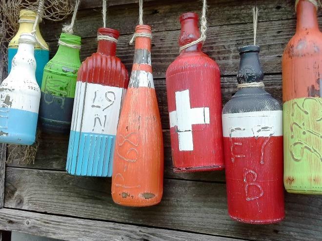 10 Best Crafty Reuses for bottles - faux nautical fishing buoys   StowandTellU.com