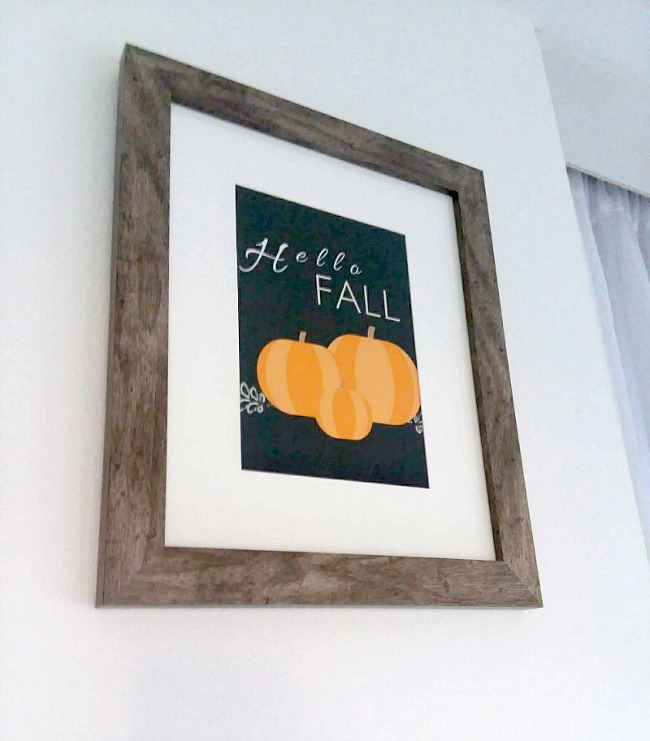 "Framed ""Hello Fall"" Printable black background, orange pumpkins, white text 