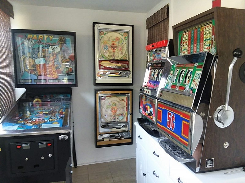 Small home arcade room with French cleat mounted pachinko cabinets | stowandtellu.com
