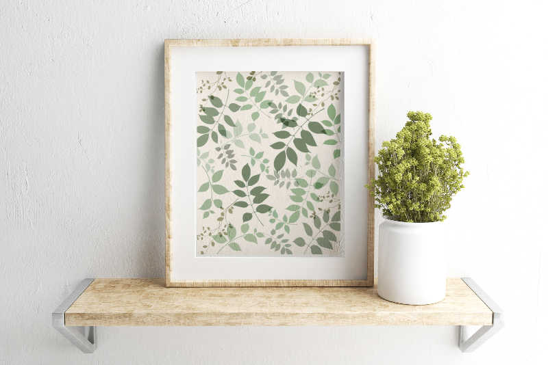 Framed printable of Botanical green leaves on off white back ground