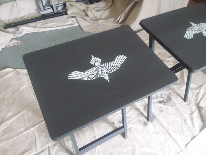 White Tribal Bird Stenciled on dark gray chalk paint table