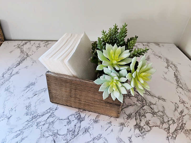 Napkin holder on marble countertop