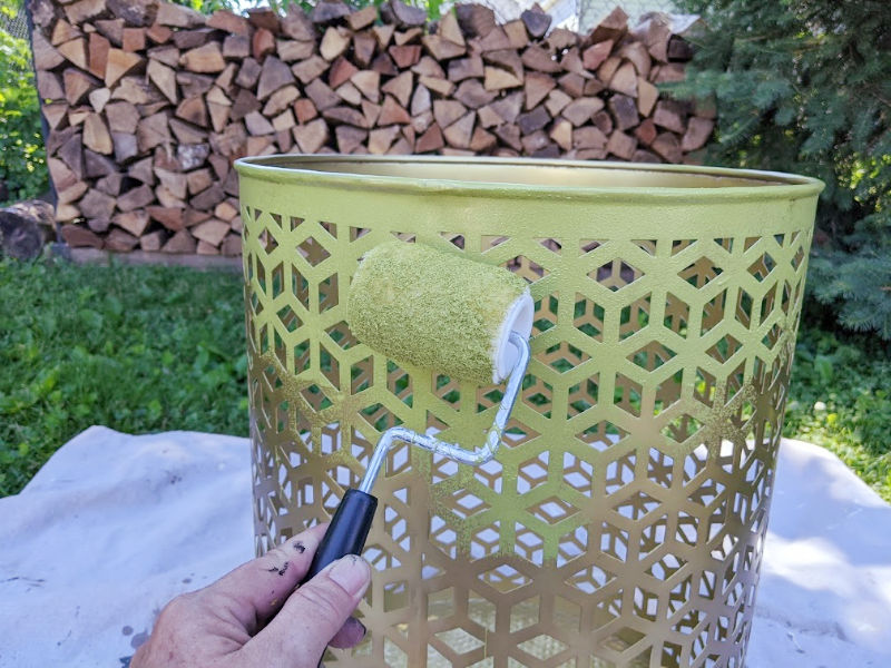 Painting outdoor metal table with a paint roller