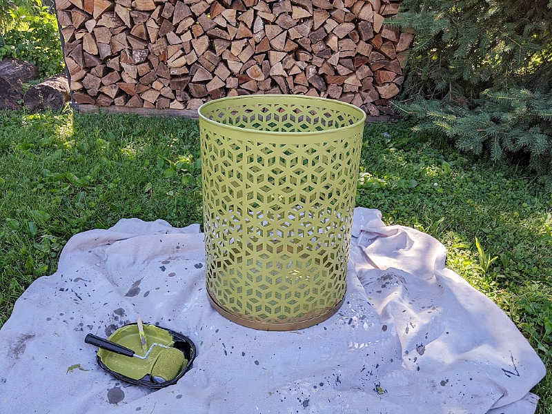Green painted metal round side table, paint and roller