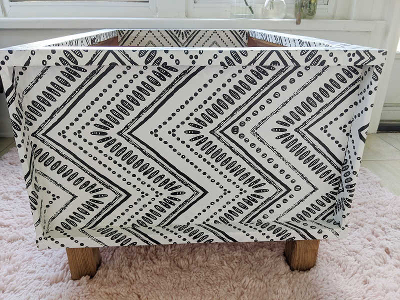 side angle of wallpapered bench