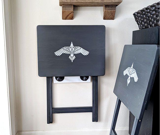 Dark gray t.v. trays mounted on wall