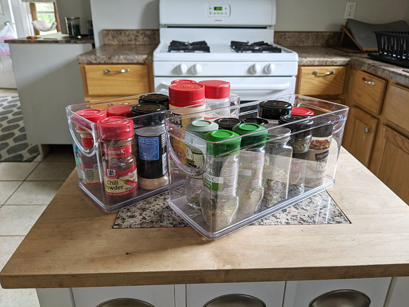 Clear plastic bins filled with spice jars