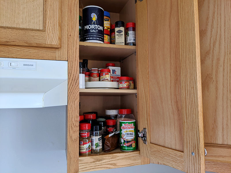 unorganized spice cabinet