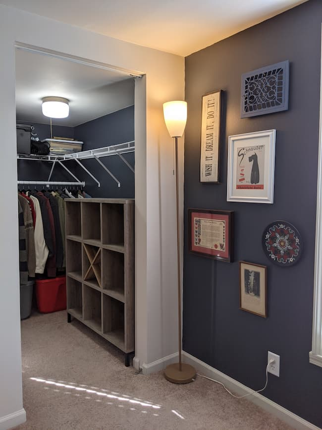 Dark blue painted walls and closet, cube storage
