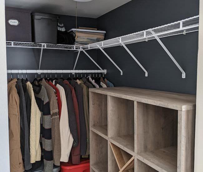 Budget closet makeover, dark blue walls, cube storage