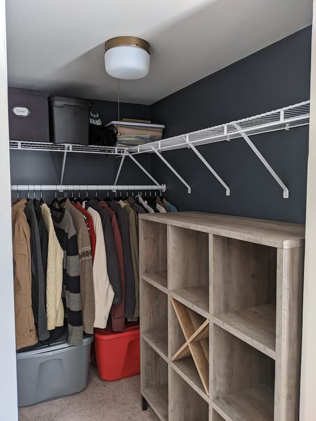 Budget closet makeover, dark blue walls, cube storage