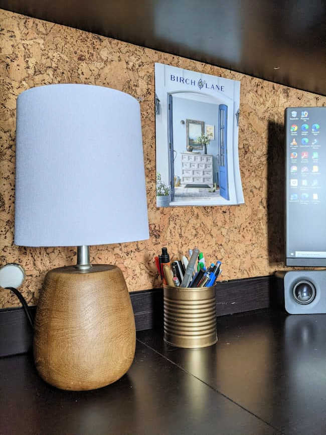 cork desk with wood toned lamp
