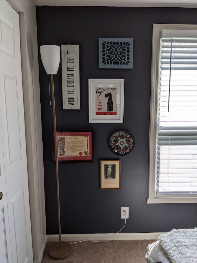 dark blue bedroom with gallery art wall