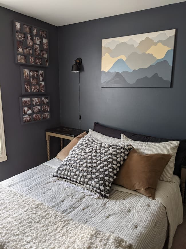 dark blue bedroom with gray bedding