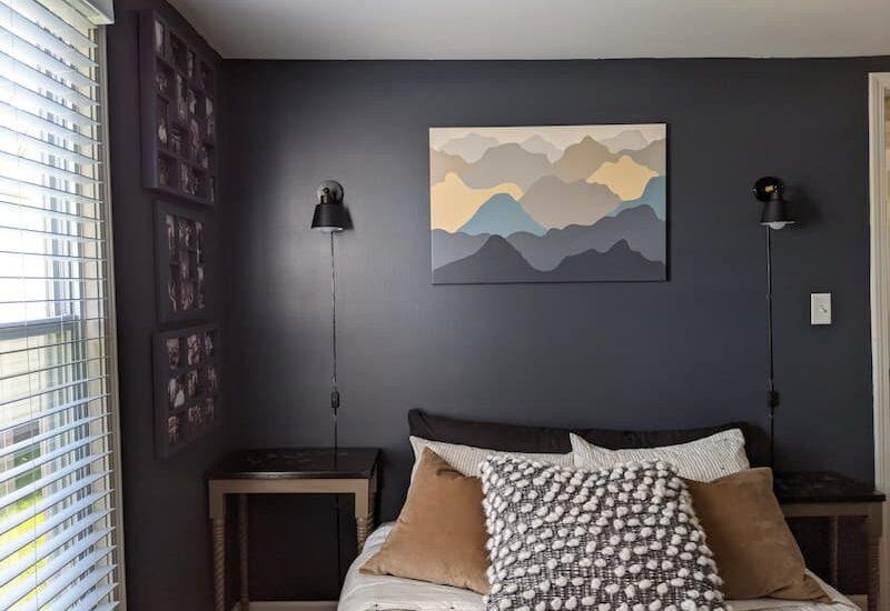 dark blue bedroom with plugin lamps