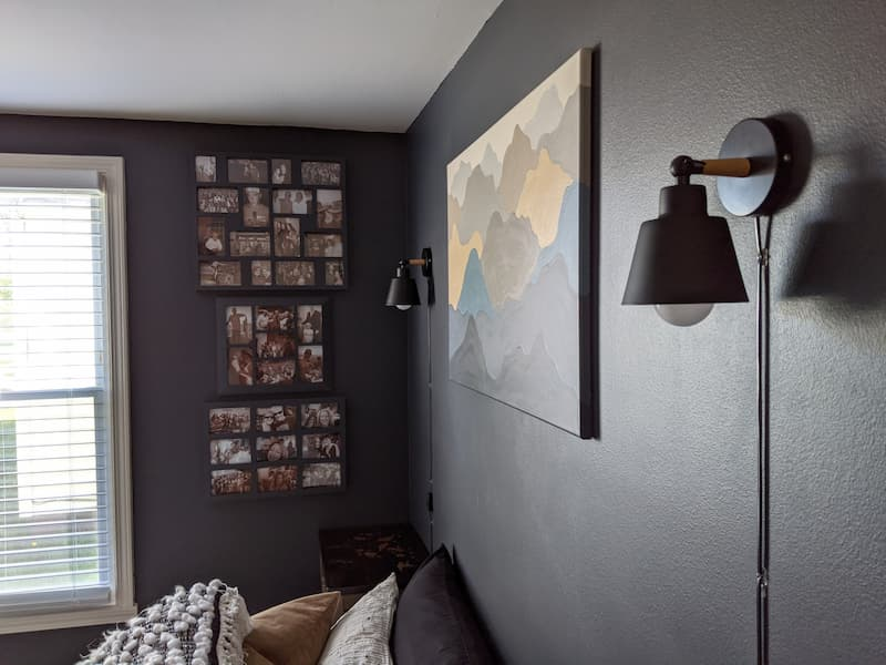 navy blue bedroom with plug-in lamps