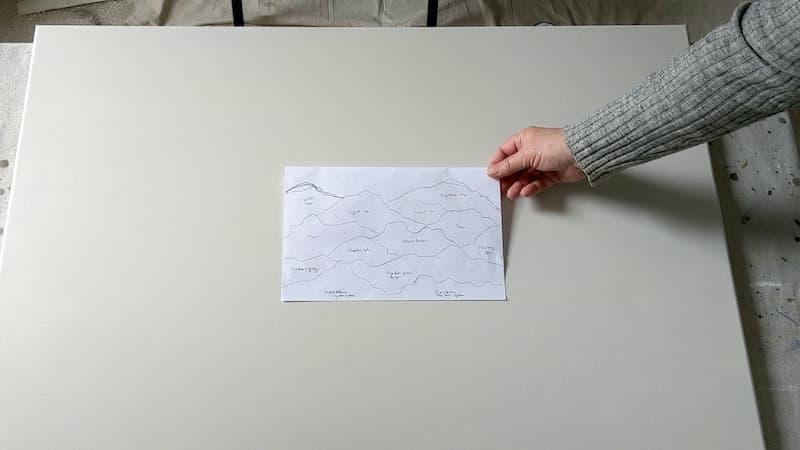 pre-draw mountain design on paper