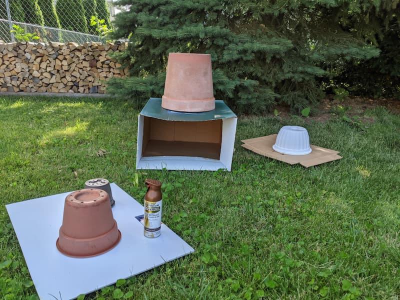 garden containers on cardboard tarps, spray paint