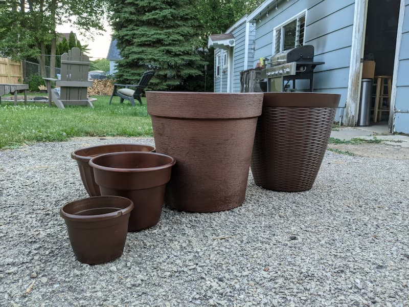 copper-rust spray painted plastic plant containers