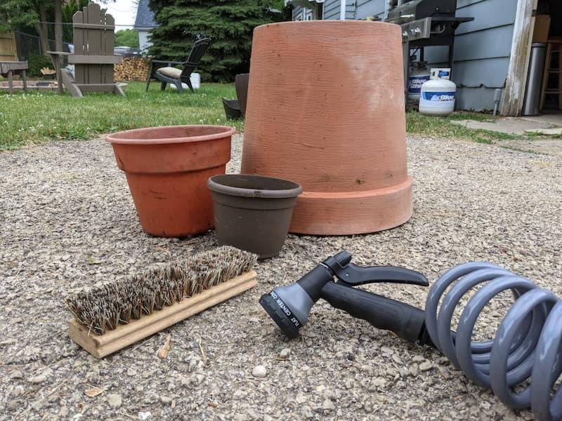 scrub brush, hose, containers