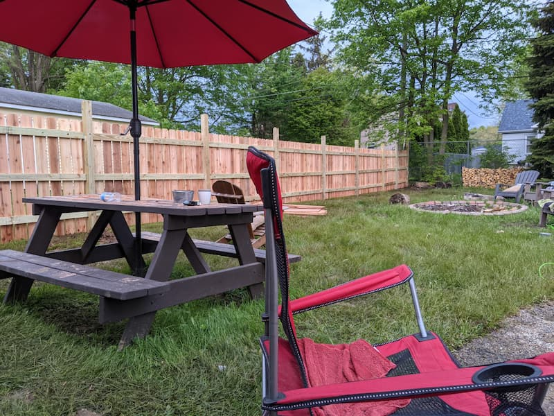 Wood fence installation near completion